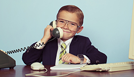 child in business suit answering the phone