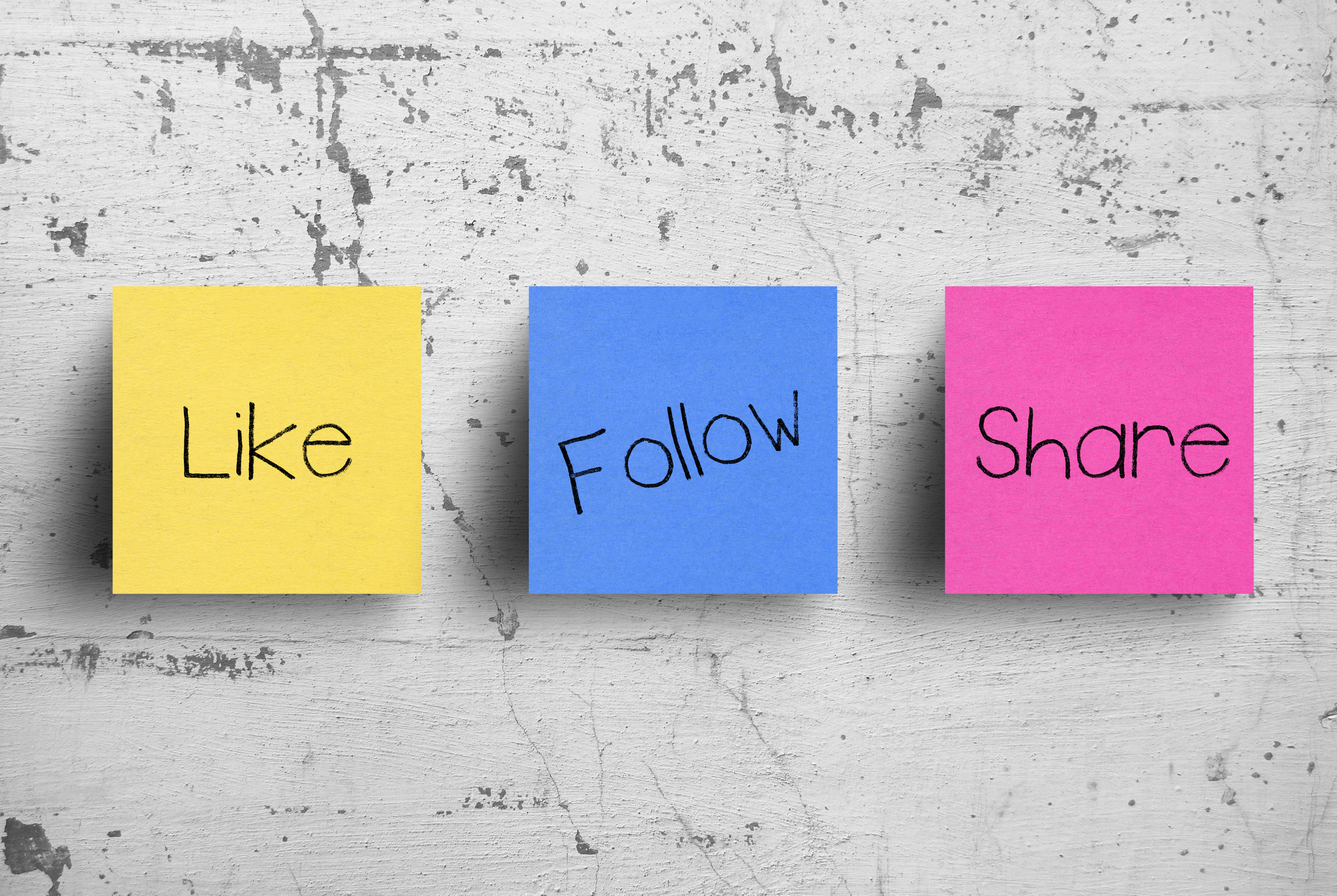like, follow, and share written on post-it notes
