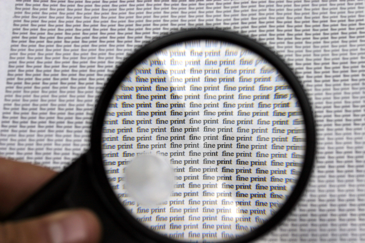 magnifying glass held over page that reads fine print